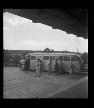 View of passengers boarding Johnston's Airways Transport bus Kiwi 2, Auckland Railway Station