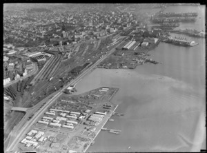 View of Mechanics Bay and the Ports of Auckland dock area, with Auckland Railway Station and the city CBD beyond