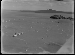 View of a yacht race on Auckland Harbour with Northhead and Rangitoto Island beyond