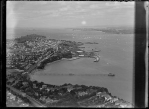 View of the Naval Base at Devonport with a yacht race on Auckland Harbour beyond