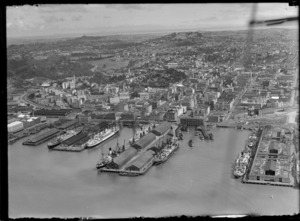 Auckland City waterfront, with some unidentified ships docked at the wharves