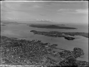 Auckland City and wharves, showing Rangitoto Island in the background