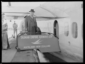 Right Honourable Walter Nash, about to board a Tasman Empire Airways Limited aircraft, Auckland, New Zealand