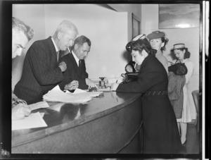 Passengers filling forms at customs, Tasman Empire Airways Ltd, Auckland