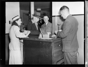 Passengers changing their currency at TEA (Tasman Empire Airways) office, Auckland