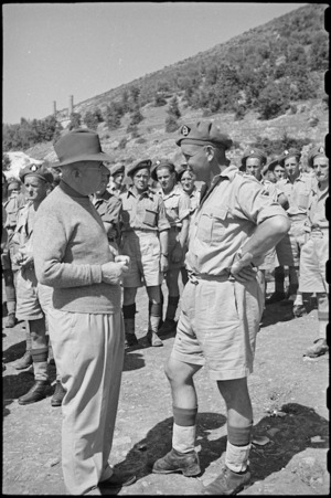 Prime Minister Peter Fraser talks with a friend while touring New Zealand troops on the Italian Front, World War II - Photograph taken by George Bull