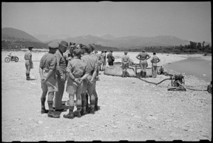 Prime Minister Peter Fraser visits waterpoint during tour of NZ troops in the Volturno Valley area, Italy, World War II - Photograph taken by George Bull