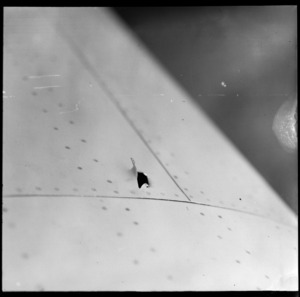 Bullet hole in the wing of Tasman Empire Airways Ltd Short S 30 Empire flying boat 'Awarua', made by a United States fighter plane