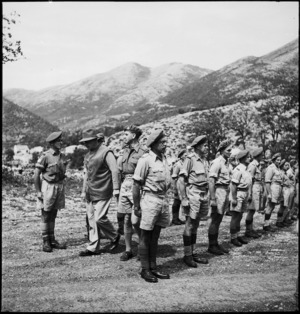 Prime Minister Peter Fraser inspecting 7 NZ Anti-Tank Regiment in Italy, World War II - Photograph taken by M D Elias