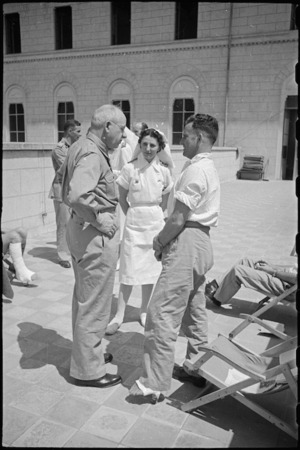 B L Rees talks to Prime Minister Peter Fraser on the roof of 1 NZ General Hospital, Molfetta, Italy, World War II - Photograph taken by George Bull