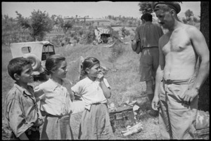 A G Trotter talks to three children who have wandered into artillery positions near Sora, Italy, World War II - Photograph taken by George Kaye