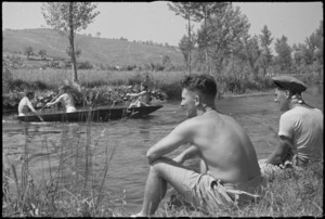 J Mahon and J Elliott watching boating on the Fibrino River in Italy, World War II - Photograph taken by George Kaye