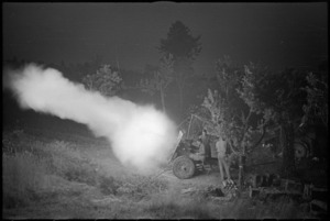 General view of New Zealand 25 Pounder firing at night near Sora, Italy, World War II - Photograph taken by George Kaye