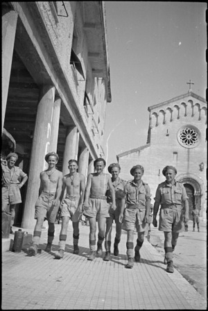 New Zealanders walk along streets of Sora, Italy, shortly after its capture, World War II - Photograph taken by George Kaye