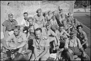 Members of 26 NZ Battalion and 27 NZ (Machine Gun) Battalion resting on Bren carriers in Sora, Italy, after its capture - Photograph taken by George Kaye
