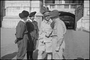 Prime Minister Peter Fraser and General Bernard Freyberg talking to Swiss Guards at gates of Vatican, Italy, World War II - Photograph taken by George Bull