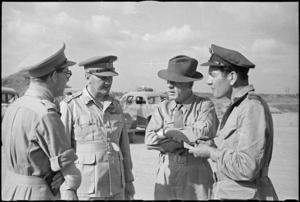 Prime Minister Peter Fraser with General Freyberg and others on Pamigliano Airfield before travelling to Rome, World War II - Photograph taken by George Bull