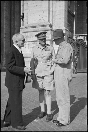 Prime Minister Peter Fraser and General Bernard Freyberg met by Vatican official, Italy, World War II - Photograph taken by George Bull