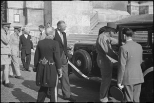 Prime Minister Peter Fraser enters Vatican car to attend audience with the Pope, Italy, World War II - Photograph taken by George Bull