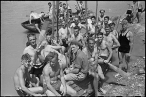 Boat crews waiting to take part in the 'Napoli Nebelwerfer's Nudge' at 24 NZ Battalion's aquatic derby at Arce, Italy, World War II - Photograph taken by George Kaye