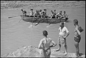 Boat crew sets out for starting point in race at 24 NZ Battalion's swimming and boating carnival at Arce, Italy, World War II - Photograph taken by George Kaye