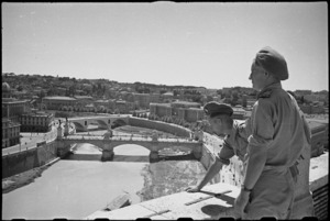 W M Everest and A M Horneman on leave in Rome, Italy, look across the Tiber towards the city - Photograph taken by George Kaye