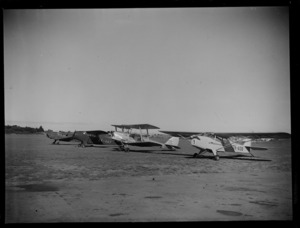 A line up of small aeroplanes at Mangere Airport, Auckland, including a Rearwin Sportster, ZK-AKF, and an Auster J-1B Autocrat, ZK-AOB