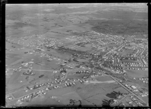 Passenger Transport Company coverage with general views over an outer unidentified [Auckland?] suburb with train station, sports ground and houses, surrounded by farmland