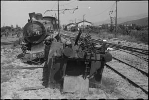 Wrecked railway engine and wagon in station yard at Terontola, Italy, World War II - Photograph taken by George Kaye