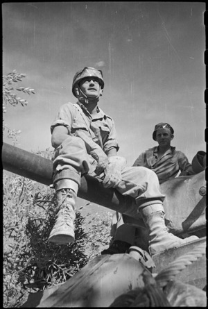 Member of a New Zealand tank crew views countryside while seated on the gun, Italy, World War II - Photograph taken by George Kaye