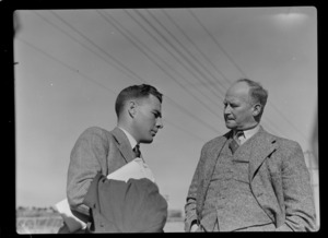 Portrait of (L to R) Mr F D Baithwaite of TEAL and Mr G M Hare of NZ NAC, [Mechanics Bay, Auckland City?]