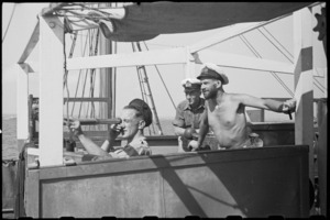 Lieutenant H L Mallitte and crew watching results of practice shoot on a World War II minesweeper in Adriatic Sea - Photograph taken by George Bull
