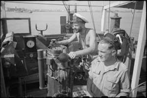 Lieutenant H L Mallitte and Signalman R Geraghty on bridge of World War II minesweeper entering port at Bari, Italy - Photograph taken by George Bull