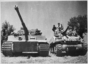 New Zealand Sherman tank alonside a German Tiger tank in La Romola, Italy, World War II - Photograph taken by George Kaye