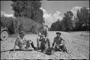 New Zealand soldiers brew up in the dry Pisa River bed near Florence, Italy, World War II - Photograph taken by George Kaye