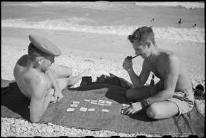 G R Ireland and T W Spooner play cards on the beach near Ancona, Italy, in World War II - Photograph taken by George Kaye