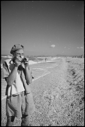 G R Waters, with camera, records day on beach near Ancona, Italy, World War II - Photograph taken by George Kaye