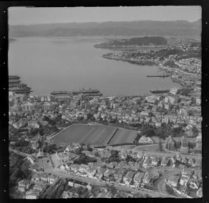 View east over Wellington City with Victoria University, the Cable Car and Kelburn Park in the foreground to the Lambton Harbour waterfront, Oriental Bay and Mount Victoria
