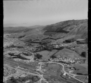 View of Porirua Railway Station and motorway to hospital and Colonial Knob to the borough of Tawa beyond, Porirua District, Wellington Region