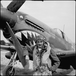 Flying Officer R H Newton beside aircraft on airfield in Italy, World War II - Photograph taken by Cedric Mentiplay