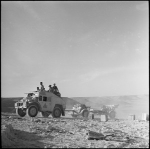 A 6 New Zealand Field Regiment tractor and gun climbing Halfaya Pass in Egypt, World War II - Photograph taken by H Paton