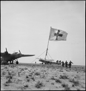 Stretcher bearers transferring wounded to air ambulance during World War II, Tunisia - Photograph taken by H Paton