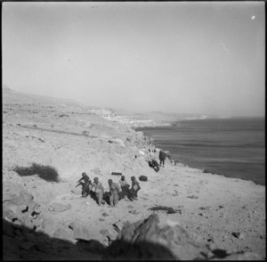 Stretcher bearers bring wounded to safety zone near Sollum, Egypt, during World War II