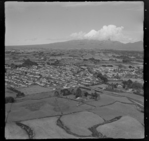 View over Inglewood with Mountain Road in foreground to Rimu Street through town, to farmland and Mount Taranaki beyond