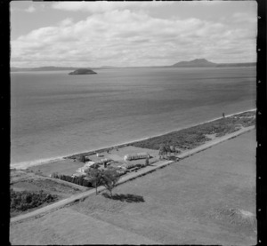View of the settlement of Tauranga Taupo with houses on Waitetoko Road to Motutaiko Island beyond, eastern side of Lake Taupo