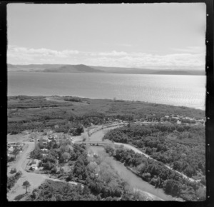View of the settlement of Oruatua and the Tauranga Taupo River with State Highway 1 and bridge on the eastern side of Lake Taupo