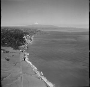 View to the White Cliffs and the peninsula settlement of Pukearuhe south along the Taranaki coastline back to Mount Taranaki, North Taranaki Region