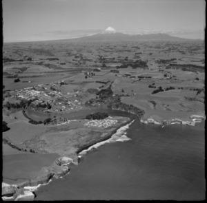 View of the north New Plymouth coastal settlement of Urenui with Mount Taranaki beyond, North Taranaki Region