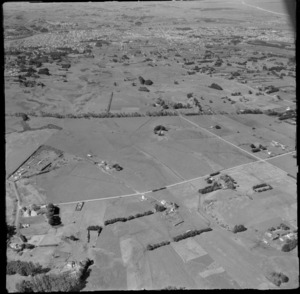 View over farmland with farm buildings in foreground to the city of Whanganui beyond, Manawatu-Whanganui Region