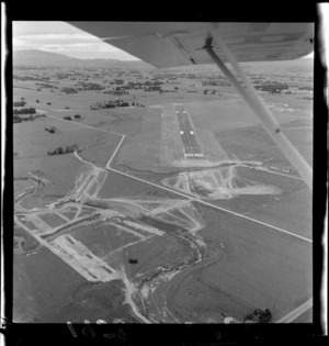 Aerial view of airport under construction, Palmerston North, Manawatu-Whanganui Region, including runway and sites cleared for buildings